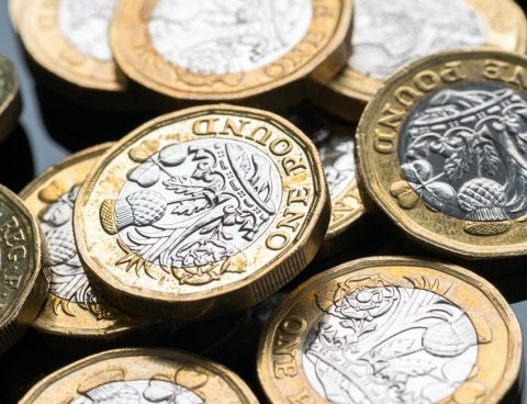 Pound coins displayed on a black surface