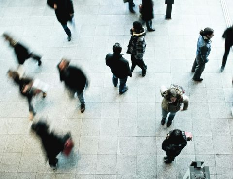 Aerial view of people walking through a crowded area