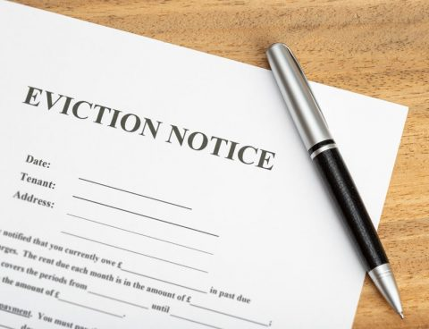 Eviction Notice on table top with pen